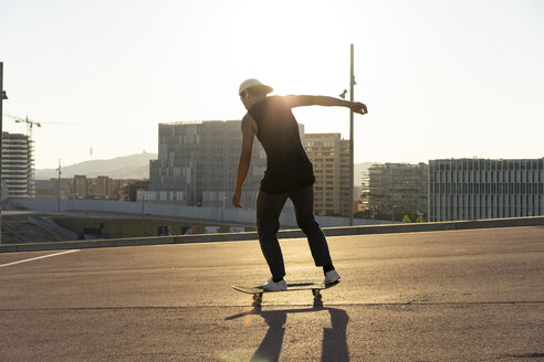 Young man riding skateboard in the city - AFVF01478