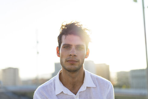Portrait of handsome young man outdoors at sunset - AFVF01487
