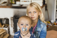 Portrait of girl with baby boy brother at home - TCF05765