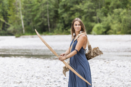 Archeress with bow and arrow in the nature - TCF05780