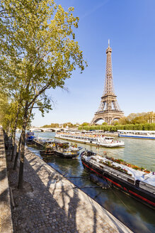 France, Paris, Eiffel Tower and tour boat on Seine river - WDF04793