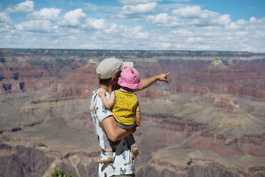 USA, Arizona, Grand Canyon National Park, father and baby girl enjoying the view, rear view - GEMF02368