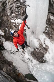 A man ice climbing in Marble Canyon, Kootenay National Park, British Columbia, Canada. - AURF02044