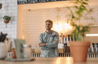 Young man working in his start-up cafe, portrait - GUSF01216