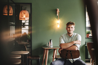 Young business owner sitting in his coffee shop - GUSF01231