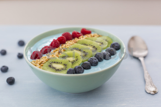 Smoothie bowl with blueberries, raspberries, kiwi and chopped hazelnuts - JUNF01097