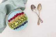 Smoothie bowl with blueberries, raspberries, kiwi and chopped hazelnuts - JUNF01100
