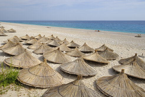 Albania, Ionean sea, Albanian Riviera, sunshades on the beach of Dhermi - SIEF07967