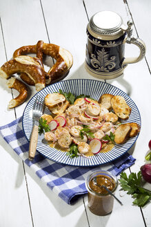 Bavarian veal sausage salad with roasted pretzel rolls, sweet mustard, pretzels, red radish and beer mug - MAEF12725