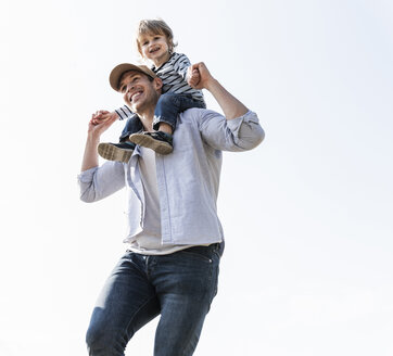 Happy father carrying son on his shoulders - UUF14993