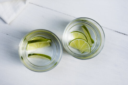 Two glasses of water with sliced limes - RAMAF00040