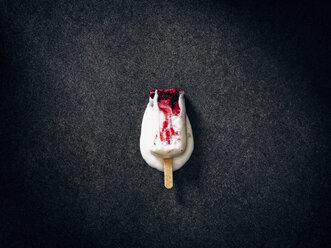 Melting homemade ice cream with berries on dark ground - RAMAF00079