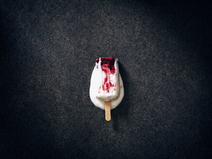 Melting homemade ice cream with berries on dark ground - RAMAF00079