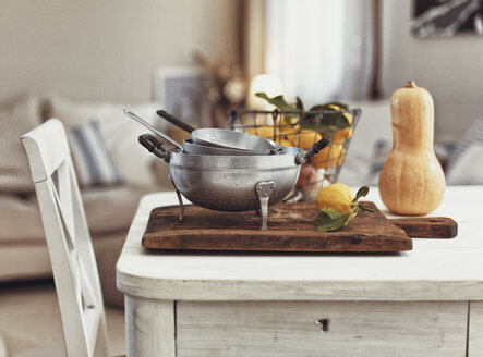 Nostalgic kitchen utensils and fruits on old wooden table - RAMAF00103