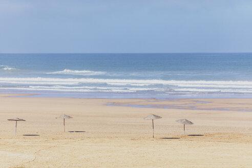 Morocco, empty beach, straw umbrellas - MMAF00525