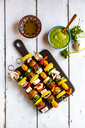 Vegetarian grill skewers, tomato, yellow and green zucchini, tofu, feta, onion and champignon, Argentinian chimichurri - SARF03925