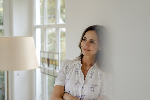 Portrait of smiling mature woman at home - KNSF04752