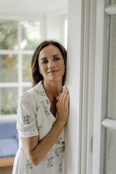 Portrait of smiling mature woman at home - KNSF04755