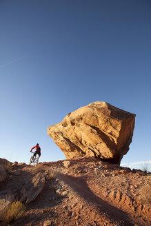 Man mountain biking the