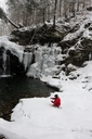 A man fly fishing on a snowy, cold winter day. - AURF02682