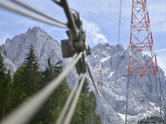 Germany, Bavaria, Garmisch-Partenkirchen, Zugspitze, installers working on poles of a goods cable lift - CVF01074