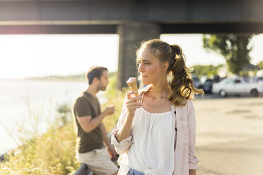 Couple eating ice cream in summer at the riverside - JOSF02600