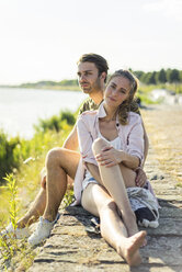 Couple relaxing at the riverside in summer - JOSF02663