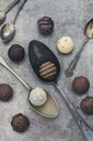 Various chocolate truffles and old spoons - JUNF01163