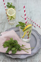 Glasses of infused water with lemon, lime and mint - JUNF01178