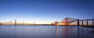 UK, Scotland, Edinburgh, Forth Bridge and Queensferry Crossing Bridge at sunset - SMAF01139