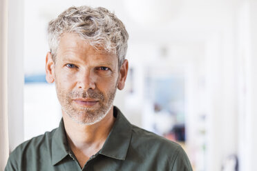 Portrait of mature man with grey hair and stubble at home - TCF05826