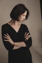 Portrait of woman wearing black dress - KMKF00452