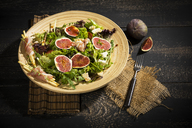 Mixed salad with figs, tomatoes, sheep cheese, grissini with ham on bambus plate - MAEF12731