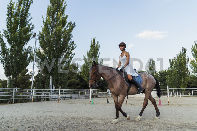 Woman riding on horse - KKAF01570