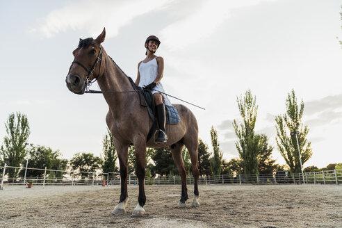 Smiling woman on horse - KKAF01582