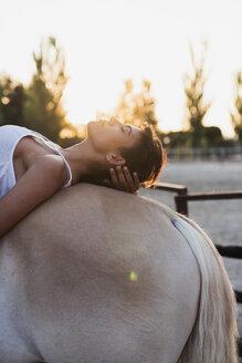 Woman relaxing on horseback - KKAF01600