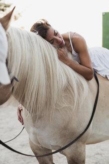 Woman relaxing on horseback - KKAF01609