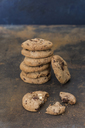 Stack of chocolate cookies on rusty metal - JUNF01243