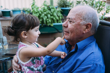 Grandfather and baby girl playing together on the terrace - GEMF02390