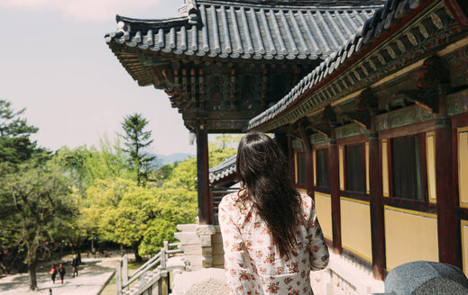 South Korea, Gyeongju, woman visiting Bulguksa Temple - GEMF02394