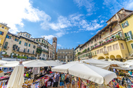 Italy, Verona, view to Piazza delle Erbe with stalls and Torre del Gardello in the background - MHF00469