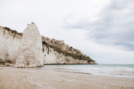 Italy, Puglia, Vieste, Scialara beach with Pizzomuno rock - FLMF00001