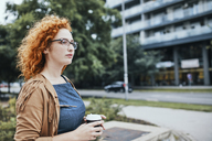 Woman going to work with a take out coffee - ZEDF01513