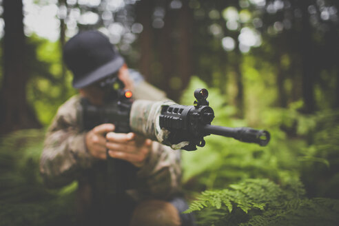 A soldier takes aim with his automatic weapon. - AURF03741