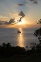 A sailboat cruises through a sunset - AURF03780