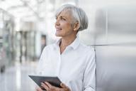 Portrait of smiling senior businesswoman holding tablet - DIGF05023