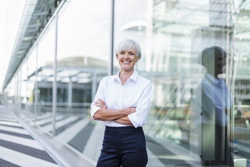 Portrait of happy senior businesswoman outside - DIGF05032