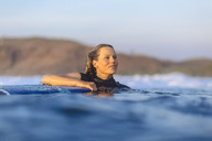 Woman surfing in sea - AURF03946