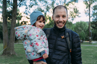 Portrait of father and little daughter having fun together in autumnal park - GEMF02411