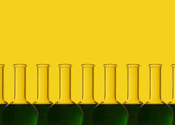 Row of test tubes with liquid, yellow background - DRBF00096